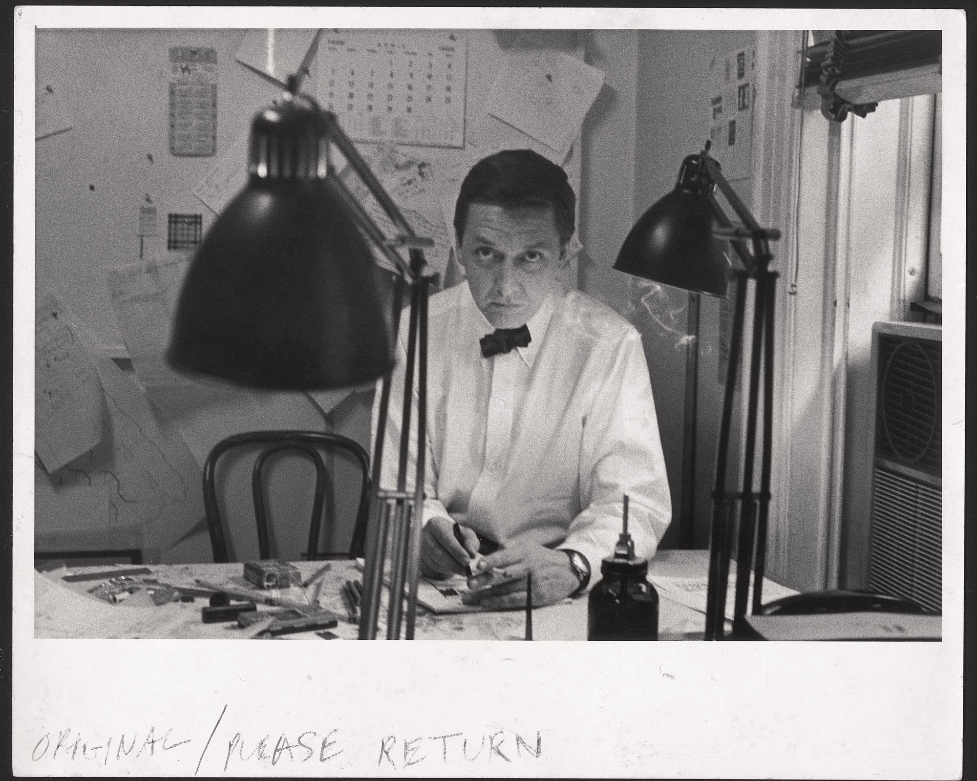 BJ at desk with lamp New York 1958